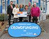 Spendenübergabe vor dem Rathaus in Schotten